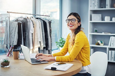 Buy stock photo Cropped portrait of an attractive young fashion designer in her workshop