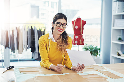 Buy stock photo Cropped shot of an attractive young seamstress working in her design studio
