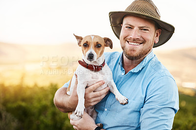 Buy stock photo Portrait of a farmer holding his dog in a vineyard