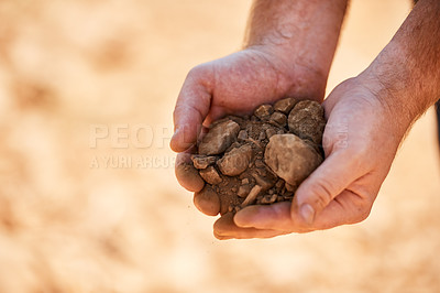 Buy stock photo Closeup shot of a farmer holding soil and rocks in his hands
