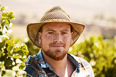 Buy stock photo Portrait of a farmer standing in a vineyard