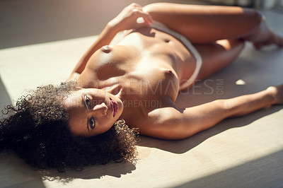 Buy stock photo Portrait of a young woman lying topless at home