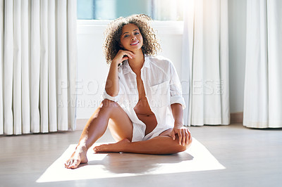 Buy stock photo Shot of a sexy young woman sitting on the floor at home