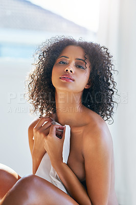 Buy stock photo Cropped shot of a beautiful young woman relaxing indoors