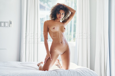 Buy stock photo Shot of a beautiful young woman posing completely nude at home