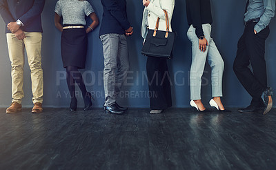 Buy stock photo Cropped studio shot of a group of well dressed businesspeople standing in line while waiting to be interview