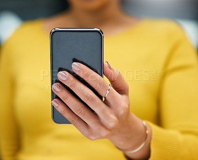 Buy stock photo Closeup shot of an unrecognizable woman using a cellphone