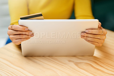 Buy stock photo Closeup shot of an unrecognizable woman using a credit card and digital tablet