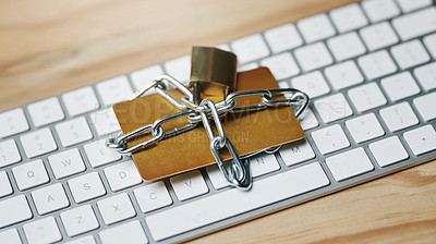 Buy stock photo Still life shot of a credit card chained up with a lock on a computer keyboard