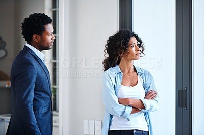 Buy stock photo Cropped shot of a young married couple having an argument at home