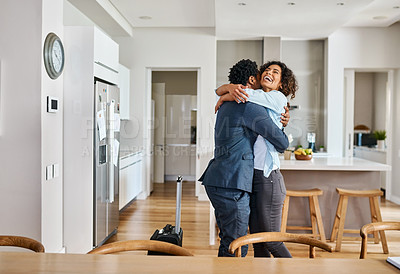 Buy stock photo Cropped shot of a young married couple embracing each other at home