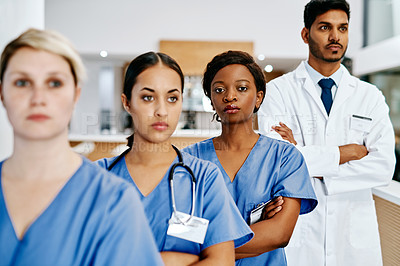 Buy stock photo Portrait of a nurse standing alongside her colleagues in a hospital