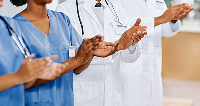 Buy stock photo Closeup shot of a group of medical practitioners applauding in a hospital