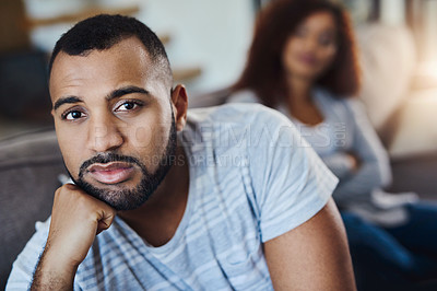 Buy stock photo Cropped portrait of a young man looking upset after having an argument with his girlfriend