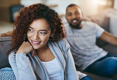 Buy stock photo Cropped shot of an attractive young woman relaxing on the sofa with her boyfriend