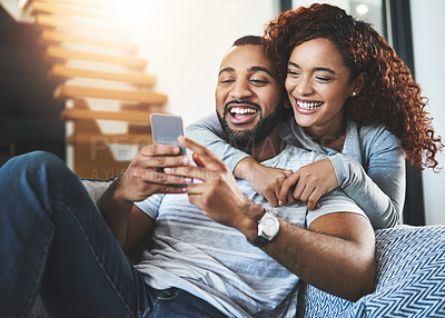 Buy stock photo Shot of a young couple at home