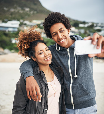 Buy stock photo Cropped shot of an affectionate  couple taking selfies on the beach