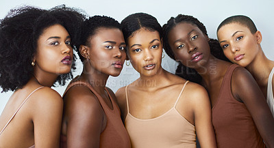 Buy stock photo Studio shot of a group of beautiful young women posing together against a gray background