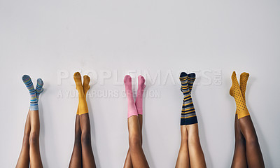 Buy stock photo Cropped studio shot of a group of women's legs in a row wearing socks