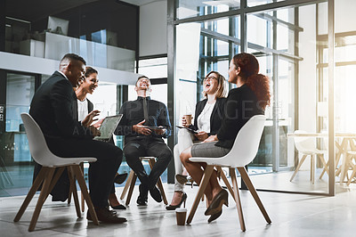 Buy stock photo Full length shot of a group of corporate businesspeople having a laugh during a meeting in the boardroom