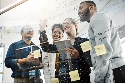 Buy stock photo Shot of a group of young businesspeople having a brainstorming session in a modern office