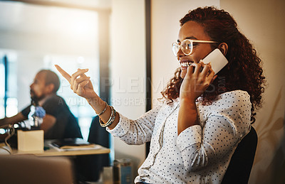 Buy stock photo Shot of a young businesswoman using a mobile phone during a late night at work