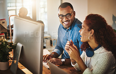 Buy stock photo Shot of a young businessman and businesswoman having a discussion during a late night at work