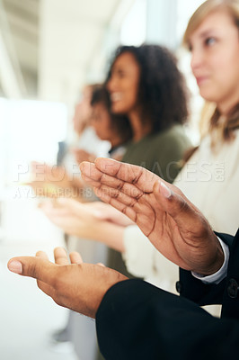 Buy stock photo Cropped shot of an unrecognizable businessman and his colleagues applauding while standing in line during a seminar