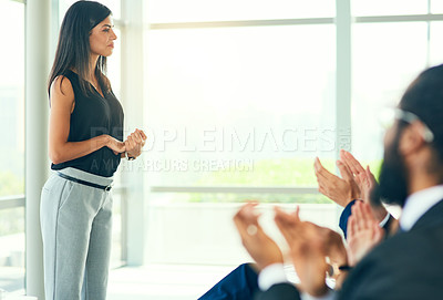 Buy stock photo Cropped shot of an attractive young businesswoman fielding questions from her colleagues during a seminar