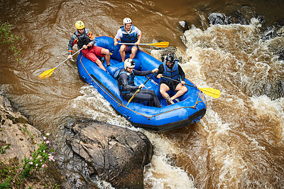 Buy stock photo High angle shot of a group of young friends white water rafting