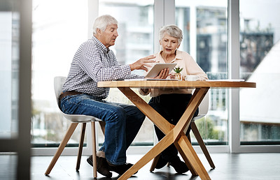 Buy stock photo Full length shot of a senior couple working on their finances at home