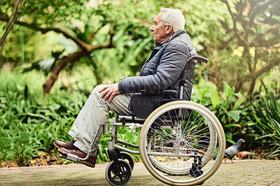 Buy stock photo Shot of a senior man spending the day outdoors in his wheelchair