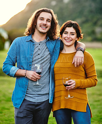 Buy stock photo Portrait of a young couple drinking wine outdoors