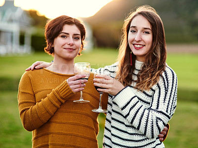 Buy stock photo Portrait of female friends making a toast outdoors