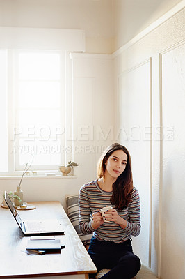 Buy stock photo Portrait of an attractive young woman working at home