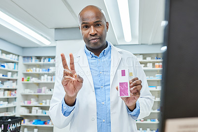 Buy stock photo Portrait of a young man explaining the dosage instructions of medication in a chemist