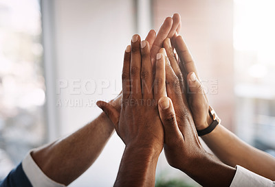 Buy stock photo Shot of an unrecognizable group of businesspeople high fiving in an office