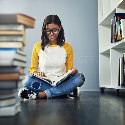 Buy stock photo Shot of a young female student studying at home