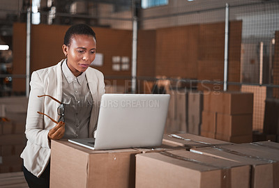 Buy stock photo Cropped shot of an attractive young female factory manager taking stock in one of her warehouses