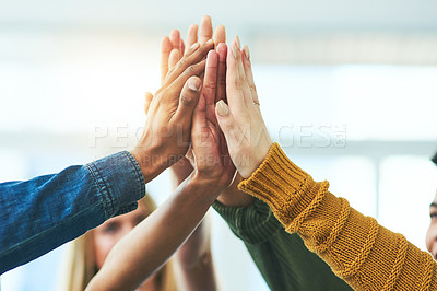 Buy stock photo Closeup shot of a diverse group of people high fiving together