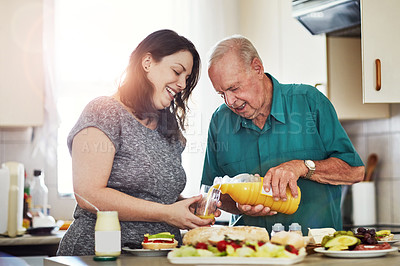 Buy stock photo Cropped shot of a woman and her senior male patient making lunch