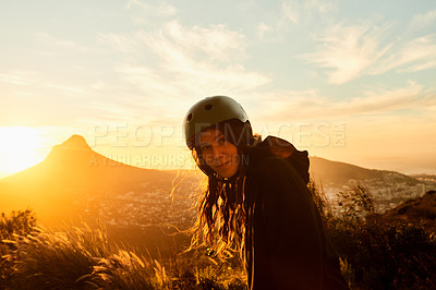 Buy stock photo Cropped shot of a young woman out skating at sunset
