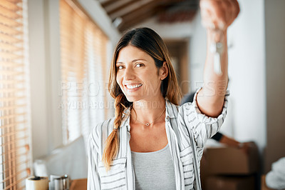 Buy stock photo Cropped shot of a woman holding up the key to her new house