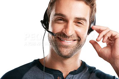 Buy stock photo Studio portrait of a handsome young man using a headset against a white background