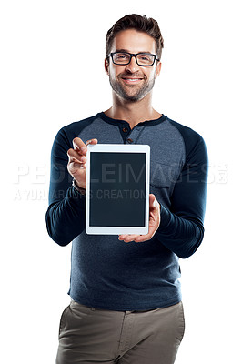 Buy stock photo Studio portrait of a handsome young man holding a digital tablet with a blank screen against a white background