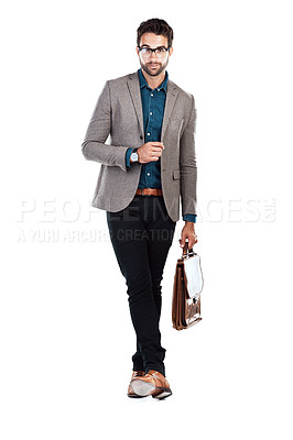 Buy stock photo Studio shot of a handsome young man posing against a white background