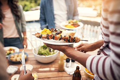 Buy stock photo Closeup of a group of friends having a meal together outdoors