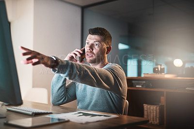 Buy stock photo Shot of a mature businessman looking worried while talking on a cellphone in an office at night