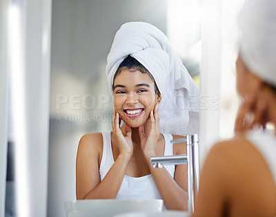 Buy stock photo Cropped shot of a beautiful young woman looking satisfied as she touches her face