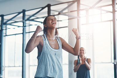 Buy stock photo Shot of a young woman celebrating a victory at the gym